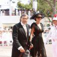 Le tennisman Ilie Nastase et sa femme Amalia arrivent dans la cour d'honneur du Palais princier où se déroule la cérémonie de mariage du Prince Albert avec Charlene Wittstock, le 2 juillet 2011 à Monaco