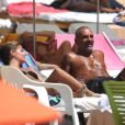 Christian Audigier et sa compagne Nathalie Sorensen en vacances à Ibiza le 25 août 2011