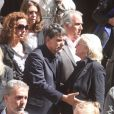 Tex et Véronique de Villèle lors des obsèques de Patrick Guillemin, en l'église Saint-Roch, à Paris, le 30 août 2011.