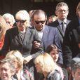 Roland Giraud et Maaike Jansen lors des obsèques de Patrick Guillemin, en l'église Saint-Roch, à Paris, le 30 août 2011.