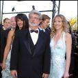 George Lucas et la fille de Dick Rivers lors de la montée des marches de La Revanche des Sith à Cannes le 14 mai 2005