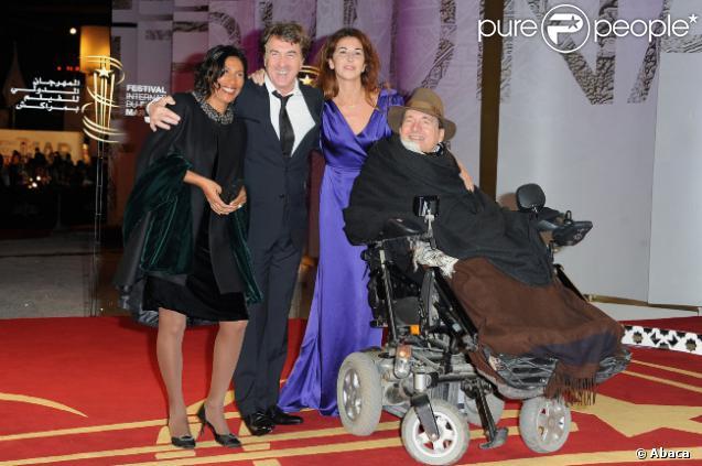 François Cluzet et son épouse Narjiss, avec Philippe Pozzo di Borgo et sa femme lors du festival international du film de Marrakech le 10 décembre 2011