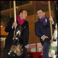 Nikos Aliagas et François-Xavier Demaison pour l'inauguration de Jours de fêtes au Grand Palais, à Paris, le 15 décembre 2011.
