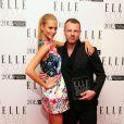 Jonny Johansson, créateur de la marque Acne, a également reçu un award des mains de Poppy Delevigne à Londres, le 13 février 2012.