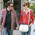 Johnny Hallyday et sa Laeticia devenue rousse font leur shopping le 8 fevrier 2012