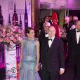 Charlotte Casiraghi, vêtue de Chanel, arrive au bal de la Rose 2012 avec son oncle le prince Albert.   A l'initiative de la princesse Caroline de  Monaco, présidente de la Fondation Princesse Grace, le Bal de la Rose 2012 a transformé la Salle des  Etoiles du Sporting Club de Monaco selon la mode folle, colorée et rock du  Londres des années 1960, Swinging London, le 24 mars 2012.