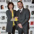 Kate Barry et Thomas Doustaly lors du dîner en l'honneur de Pierre et Gilles, et de la sortie du livre Autobiographie en photomatons, le 29 mars 2012 à Paris