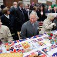 Le prince Charles et la duchesse Camilla au Big Jubilee Lunch de Piccadilly, chez Fortnum & Mason, le 3 juin 2012, pour le jubilé de diamant d'Elizabeth II.