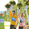 Bradley Wiggins, Maillot Jaune et vainqueur du Tour de France 2012 le dimanche 22 juillet 2012 entouré de Peter Sagan, Thomas Voeckler et Tejay Van Garderen
