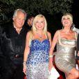 Massimo Gargia, Ivana Trump et son compagnon Marcantonio Rota à la soirée d'anniversaire de Monika Bacardi, au Moulin de Ramatuelle, le 23 juillet 2012.