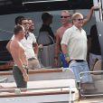 Elton John et David Furnish sur un yacht au large de St-Tropez, le lundi 13 août 2012.