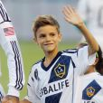 """""""Pour ses dix ans, Romeo a pu entrer sur la pelouse du Home Depot Center et accompagné son père avant le match Los Angeles Galaxy - Vancouver Whitecaps. Carson, le 1er septembre 2012."""""""