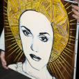 Gwen Stefani et son fils Zuma arrivent a l'aeroport a Paris le 23 Septembre 2012. Un fan lui a offert un tableau d'elle.