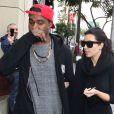 Kim Kardashian et le rappeur Kanye West quittent le restaurant Nate 'n Al à Beverly Hills. Le 24 décembre 2012.