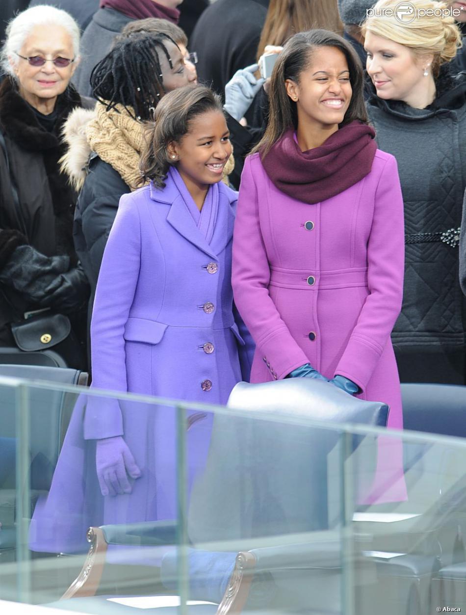 Sasha et Malia Obama portent des marques mainstream mais pointues à la cérémonie d'investiture de leur papa Barack Obama à Washington le 21 janvier 2013. Les soeurs ont choisi Kate Spade et J. Crew