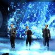 Les  Take That  se produisent sur scène lors de la finale du  X Factor  version Italie, le 23 novembre 2010.