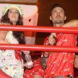 Megan Fox et son mari Brian Austin Green à Rio, admirent le défilé du Carnaval 2013