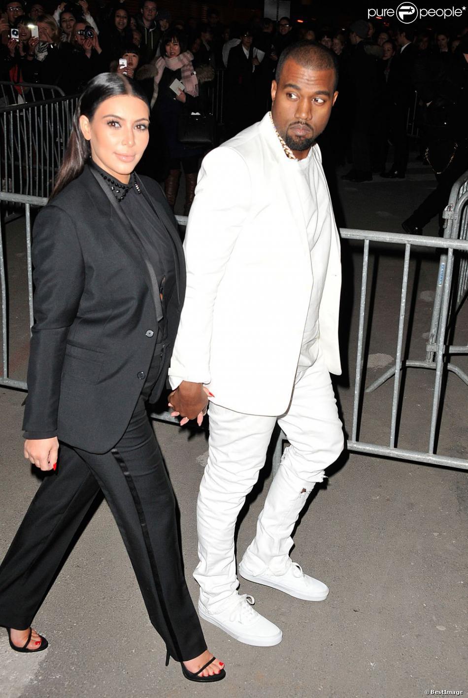 Kim Kardashian et Kanye West arrivent à la Halle Freyssinet pour assister au défilé Givenchy prêt-à-porter automne-hiver 2013-2014. Paris, le 3 mars 2013.