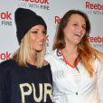 Alexandra Rosenfeld et Laure Manaudou lors d'une conférence de presse au Club Med Gym de Bastille à Paris le 19 mars 2013