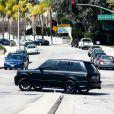 Le jeune Justin Bieber échappe aux photographes à Los Angeles, il grille alors un feu rouge et fait un demi-tour illégal, le 26 mars 2013.