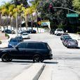 Justin Bieber échappe aux photographes à Los Angeles, il grille alors un feu rouge et fait un demi-tour illégal, le 26 mars 2013.