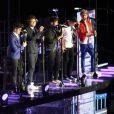 Les membres des One Direction sur scène à Londres, le 6 avril 2013. Le chanteur a terminé en boxer à cause d'une blague de Liam Payne.