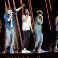 One Direction sur scène à Londres, le 6 avril 2013. Le chanteur a terminé en boxer à cause d'une blague de Liam Payne.