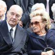Jacques et Bernadette Chiraclors des obsèques d'Antoine Veil au cimetière du Montparnasse à Paris le 15 avril 2013.