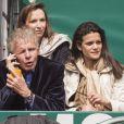 Patrick Poivre d'Arvor et son amie Caroline Glory lors de la finale de tennis du Monte Carlo Rolex Masters 1000 à Monaco le 21 Avril 2013 entre Novak Djokovic et Rafael Nadal