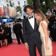Tomer Sisley et Agathe de la Fontaine à la montée des marches du film Inside Llewyn Davis lors du 66e festival du film de Cannes, le 19 mai 2013.