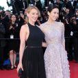 Ludivine Sagnier et Zhang Ziyi lors de la montée des marches du film La Vénus à la fourrure au Festival de Cannes le 25 mai 2013