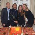 Guy Forget, Henri Leconte, sa fille Luna-Sara et son épouse Florentine lors de la soirée d'anniversaire d'Henri Leconte qui célébrait ses 50 ans au restaurant Très Honoré à Paris le 30 mai 2013