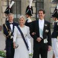 Pavlos de Grece et son épouse Marie-Chantal au mariage de la princesse Madeleine de Suède et de Chris O'Neill au palais royal à Stockholm le 8 juin 2013.
