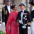 La princesse Mary et le prince Frederik au mariage de la princesse Madeleine de Suède et de Chris O'Neill au palais royal à Stockholm le 8 juin 2013.