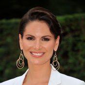 Laetitia Bléger : La Miss France 2004 souriante près de l'ex-star d'Aubade