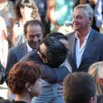 Christophe Barratier et Patrick Timsit saluent Thomas Langmann avant son mariage civil avec Céline Bosquet à la mairie de Sartène, Corse du sud, le 21 juin 2013.