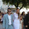 Thomas Langmann, sa fille et Céline Bosquet à leur mariage civil à la mairie de Sartène, Corse du sud, le 21 juin 2013.