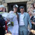 Sortie sous le riz pour le mariage civil de Thomas Langmann et Céline Bosquet à la mairie de Sartène, Corse du sud, le 21 juin 2013.