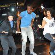 Usain Bolt, en pleine chorégraphie avec les danseurs du crew Puma The Quest au Bus Palladium. Paris, le 3 juillet 2013.