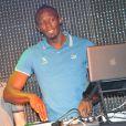 Usain Bolt aux platines pour animer la soirée Puma The Quest au Bus Palladium. Paris, le 3 juillet 2013.