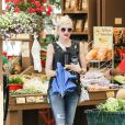 Gwen Stefani went grunge donning a sleeveless, tattered top as she took her sons Kingston and Zuma to the Underwood Family Farms in Thousand Oaks, CA, USA on July 6, 2013. Coordinating her look, the 43-year-old singer teamed her black blouse with a pair of skinny, distressed denim trousers. Photo by GSI/ABACAPRESS.COM06/07/2013 - Los Angeles