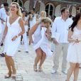 EXCLU : Cindy Lopes, déchaînée, et son compagnon lors de la White Party au Domaine de Beauregard à Courcy aux Loges, le 7 juillet 2013.