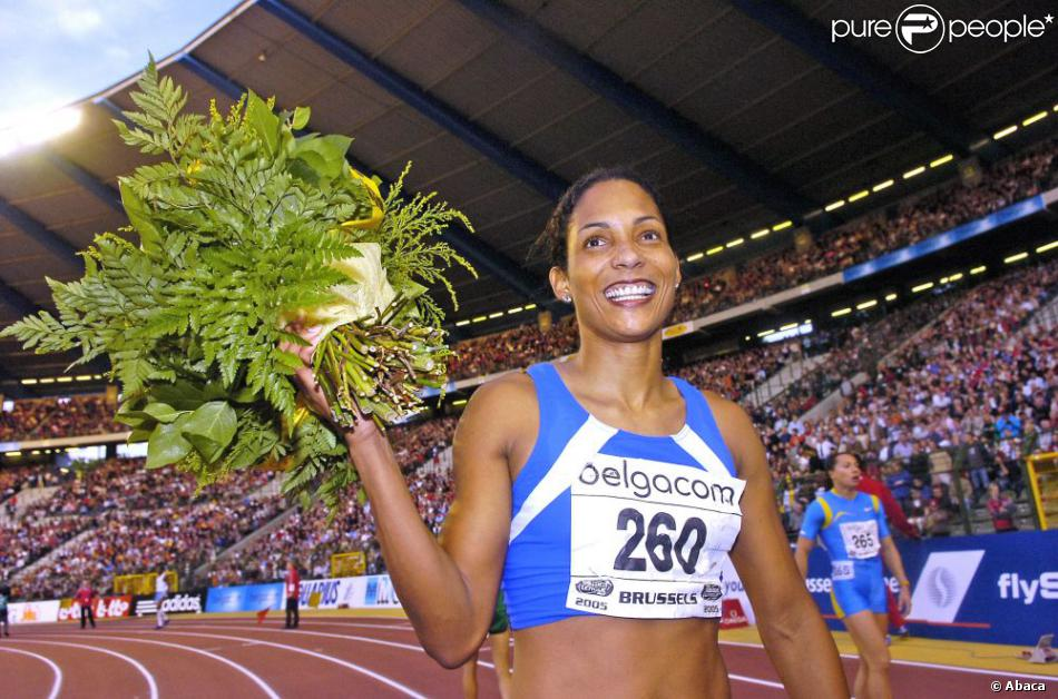 Christine Arron après sa victoire sur 100 mètres lors de l'épreuve de la Golden League qui se disputait au stade du Roi Baudouin à Bruxelles le 26 septembre 2005