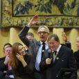 Carla Bruni-Sarkozy et Guy Roux lors de la 152e vente aux enchères des Vins des Hospices de Beaune au profit de la fondation Carla Bruni-Sarkozy et de la fondation Idee le 18 novembre 2012 à Beaune