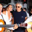 Elisabetta Gregoraci et Andrea Bocelli assistent à la White Night Party de Fawaz Gruosi, fondateur et président de la marque de Grisogono, qui fête son 61e anniversaire au Billionaire. Porto Cervo, le 8 août 2013.