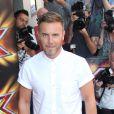 Gary Barlow lors du lancement de X Factor UK 2013 à l'hôtel Mayfair de Londres, le 29 août 2013.