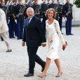 Michel Sapin et sa femmelors d'un dîner d'Etat à l'Elysée le 3 septembre 2013.