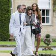 Lily Allen et son mari Sam Cooper assistent au mariage du rappeur Stephen Paul Manderson alias Professor Green et Millie Mackintosh dans le Somerset, le 10 septembre 2013.