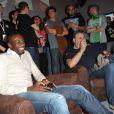 Blaise Matuidi du PSG et Pierre Ménès à la soirée de lancement de FIFA 14, organisée à la Gaîté Lyrique, à Paris, le 23 septembre 2013. La simulation de foot d'EA Sports sort le 26 septembre.
