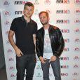 Christophe Lemaitre et Nicolas Duvauchelle à la soirée de lancement de FIFA 14, organisée à la Gaîté Lyrique, à Paris, le 23 septembre 2013. La simulation de foot d'EA Sports sort le 26 septembre.